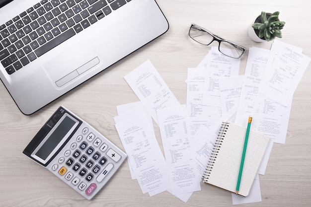 Bills and calculator with checks for goods and services