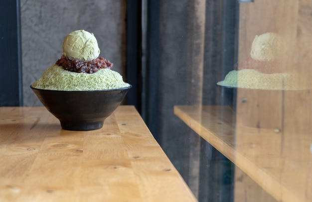 Bingsu green tea with red bean - korean dessert on wooden table great