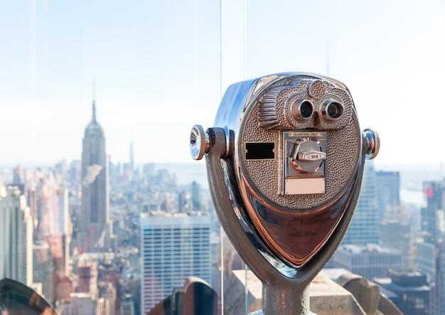 Binocular against observation deck view.
