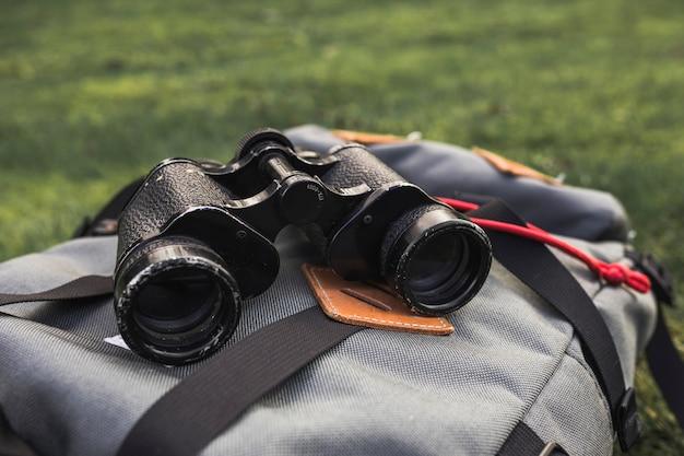 Binoculars lying on backpack