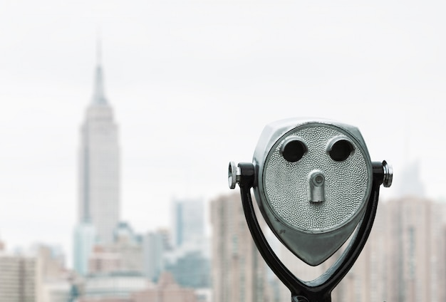 Binoculars and new york city manhattan skyline