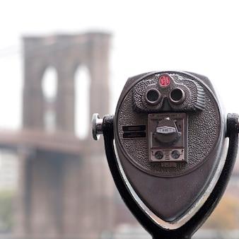 Binoculars on riverbank in manhattan, new york city, u.s.a.