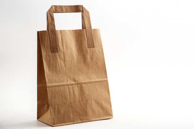 Biodegradable environmentally friendly cardboard bag on white isolated background