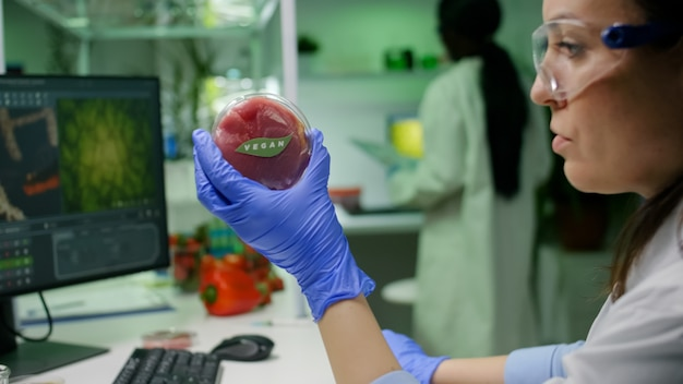 Biologist researcher looking at plant based beef substitute for vegetarien people