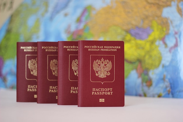 Biometric russian passports are in a row on the world map.