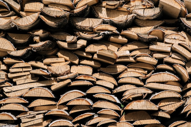 Birch wood piled in a woodpile
