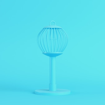 Bird cage on bright blue in pastel colors