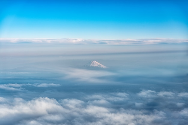 Bird eye view of fuji mountain, famous volcano in japan, shot from airplane window.