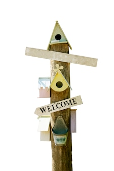 Bird house and wooden sign isolated on white,