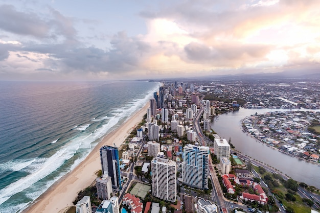 Bird's eye view of gold coast city skyline and ocean at sunset