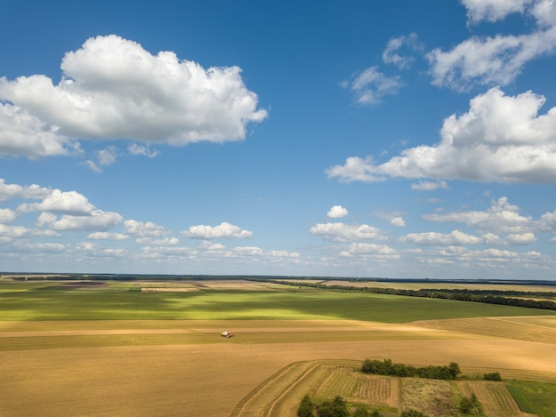 Bird's eye view of rural countryscape with clouds on a blue sky background in a summer sunny day. aerial view from drone.