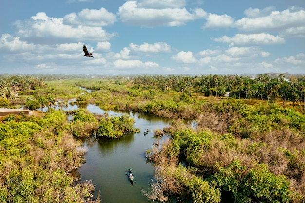 Bird's eye view of a wetland with people riding on boats and enjoying nature