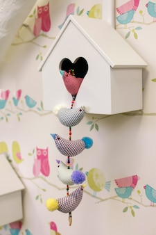 Birdhouse hanging on the wall.