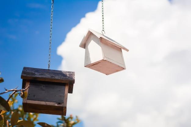 Birdhouse on sky background.background concept.