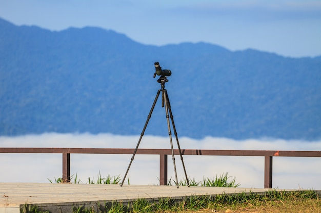 Birdwatching monocular or spotting scope on a tripod in forest