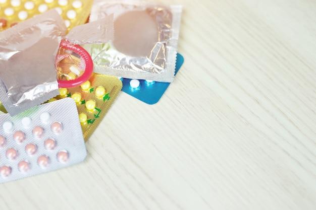 Birth control pills with condoms
