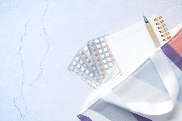 Birth control pills on wooden background close up