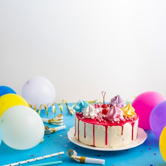 Birthday cake and colorful balloons