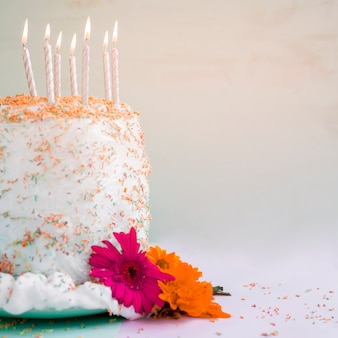 Birthday cake in front of watercolor background