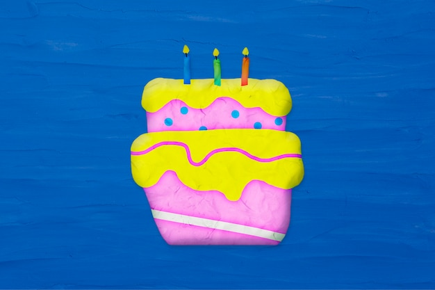 Birthday cake in plasticine clay style