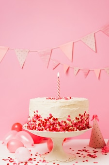 Birthday cake with candle and confetti