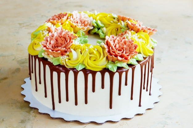 Birthday cake with flowers rose on white