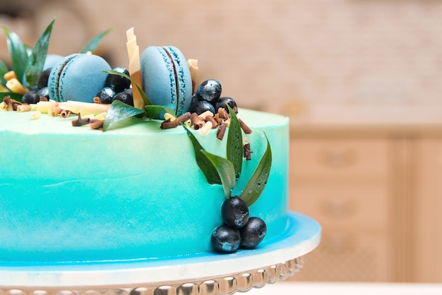 Birthday cake with french macaroon and blueberries.