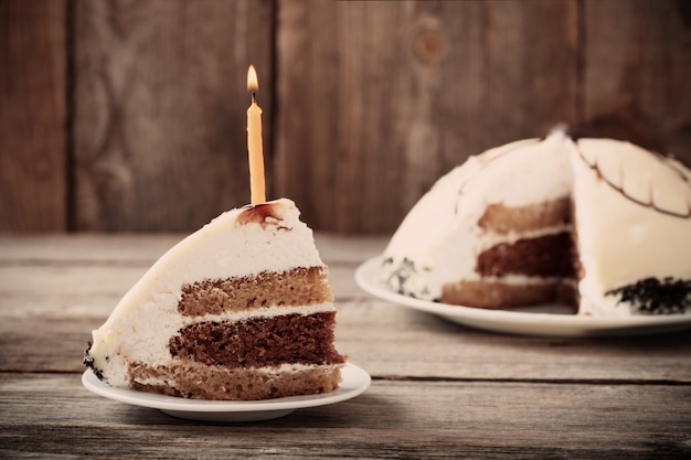 Birthday cake on wooden surface
