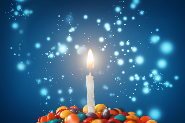 Birthday candle on delicious  cupcake with candies  on light blue  background.holidays greeting card