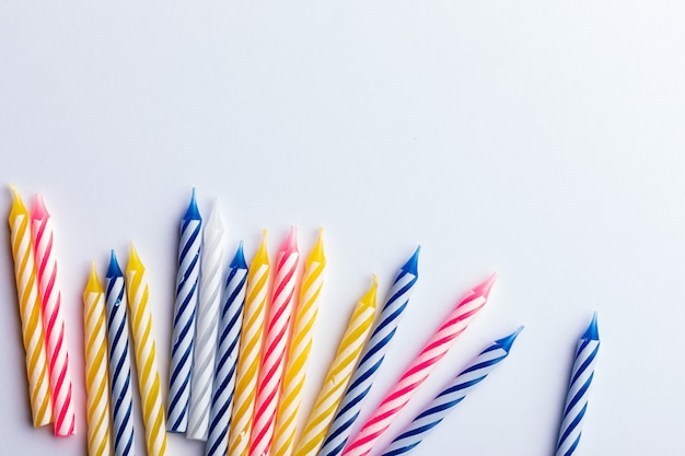 Birthday candles on white background.