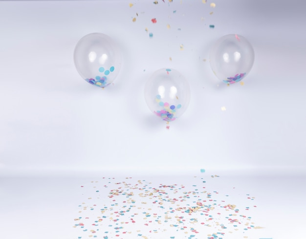 Birthday celebration stage with transparent balloons and confetti