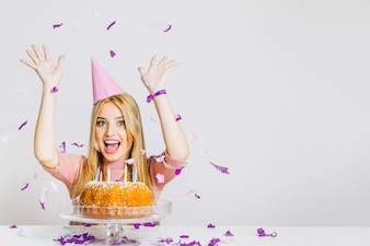 Birthday concept with girl throwing confetti