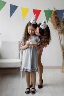 Birthday concept. a young woman and her beautiful daughter are smiling and laughing.