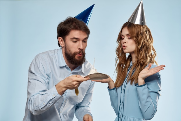 Birthday corporate young man and woman with cake on isolated disco party