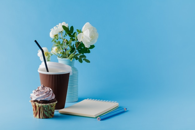 Birthday cupcake on blue background