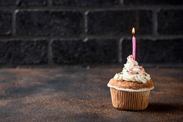Birthday cupcake with cream and candle
