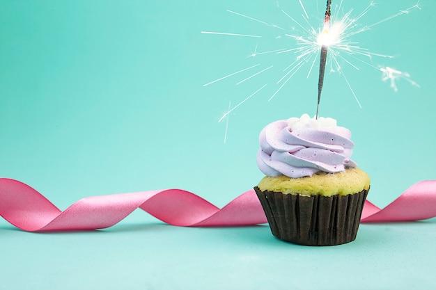 Birthday cupcake with sparkler.