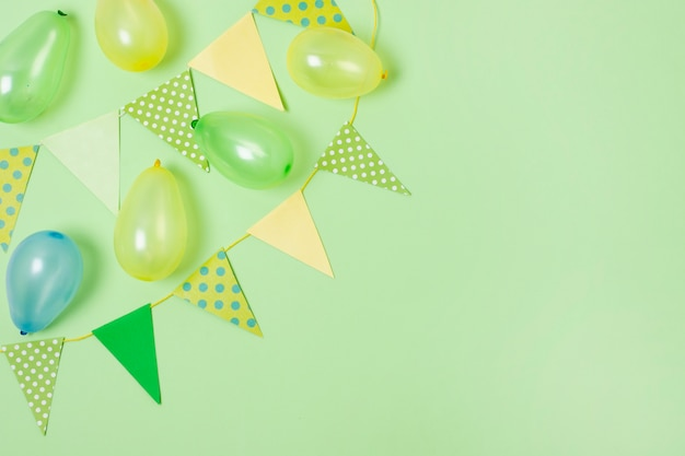 Birthday decoration on green background with copy space