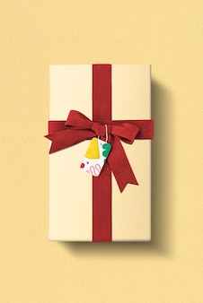 Birthday gift box with red ribbon and plasticine patterned tag