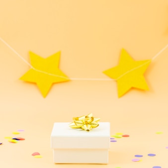 Birthday gift with stars and confetti