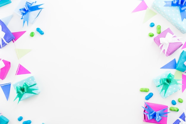 Birthday gifts; candies and bunting on white background