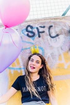 Birthday girl holding balloons