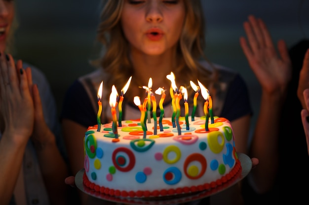 Birthday. girls with a cake with candles. Premium Photo