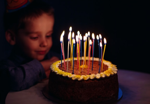 Birthday. a little boy blows out candles on the stoke.