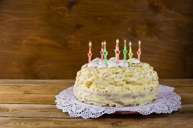 Birthday meringue cake with burning candles