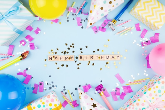 Birthday party attributes colorful balls confetti gifts candles for cake phrase happy birthday