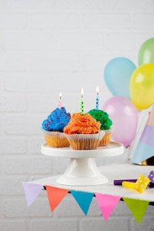 Birthday party cupcakes with candles