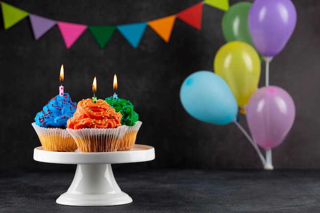 Birthday party cupcakes with colorful balloons