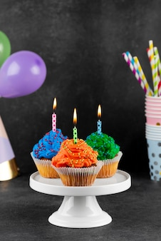 Birthday party cupcakes with lit candles