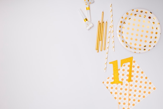 Birthday supplies on white background with copy space